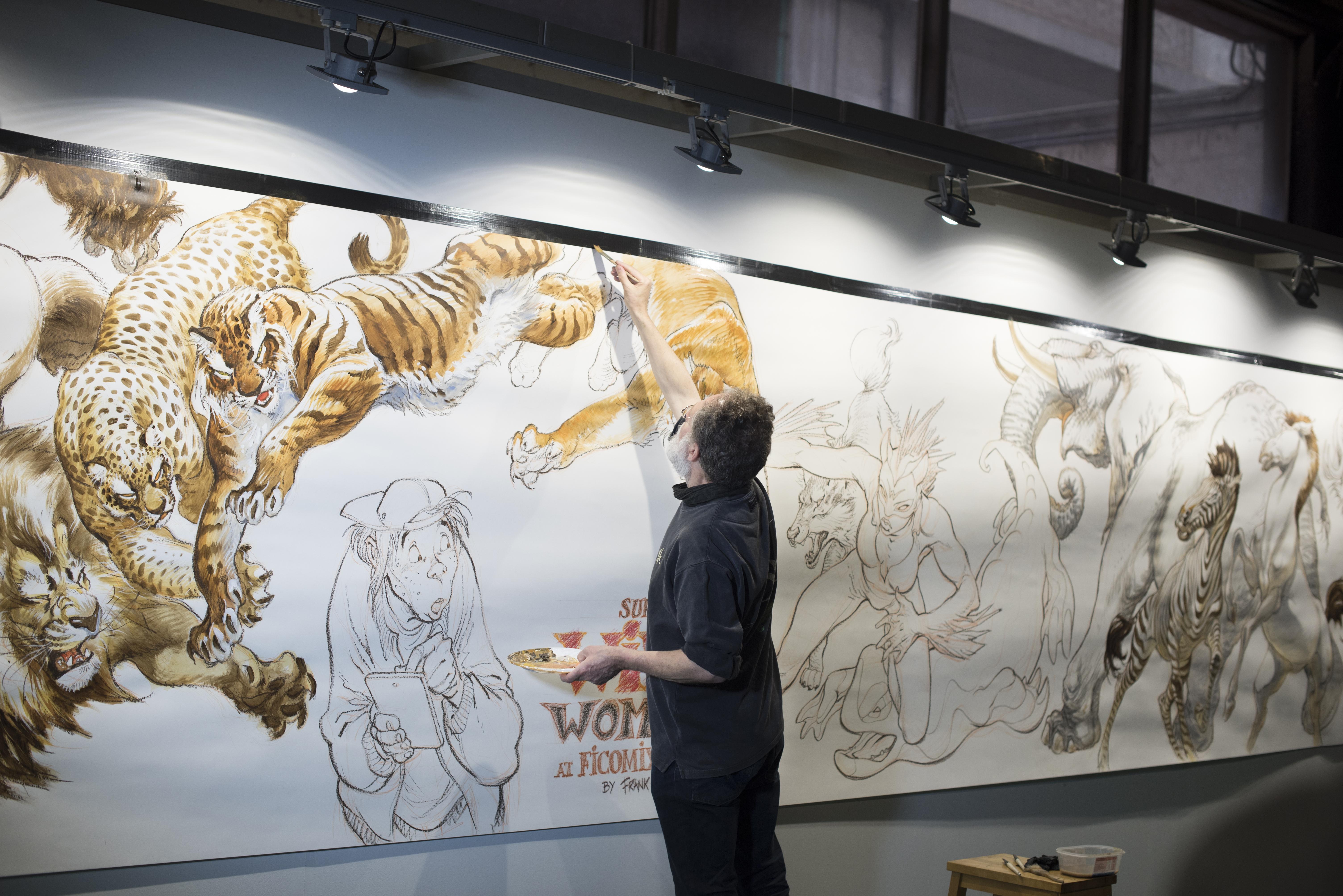 El belga Frank Pé dibujando un mural en vivo.